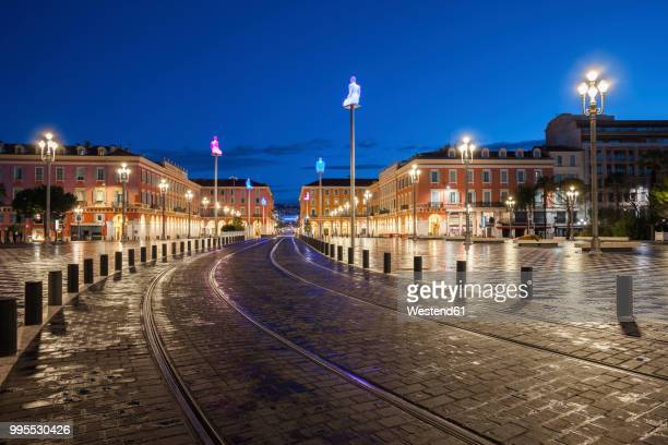 France, Provence-Alpes-Cote d'Azur, Nice, tramway on Place Massena at blue hour