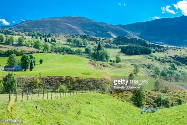 france, pyrenees national park, hautes-pyrenees, argeles-gazost valley, climb to the hautacam station, barns and beehives. - hautes pyrenees stock pictures, royalty-free photos & images