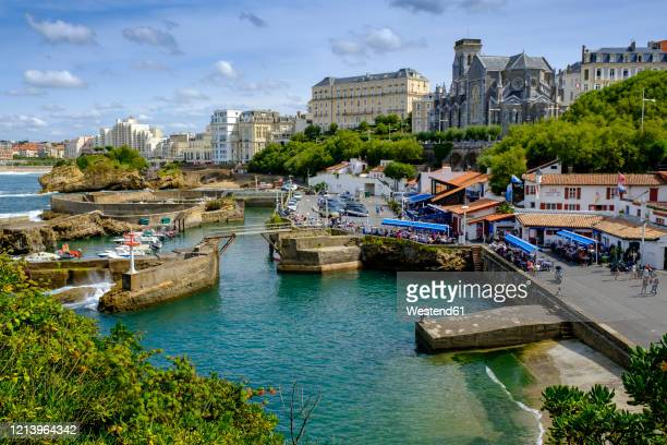france, pyrenees-atlantiques, biarritz, le port des pecheurs marina with church of saint eugenie in background - biarritz stock pictures, royalty-free photos & images