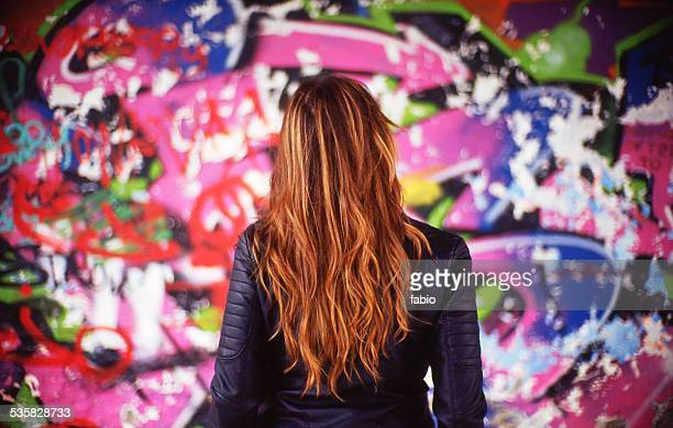france, rear view of young woman in front of colorful mural - street art stock pictures, royalty-free photos & images