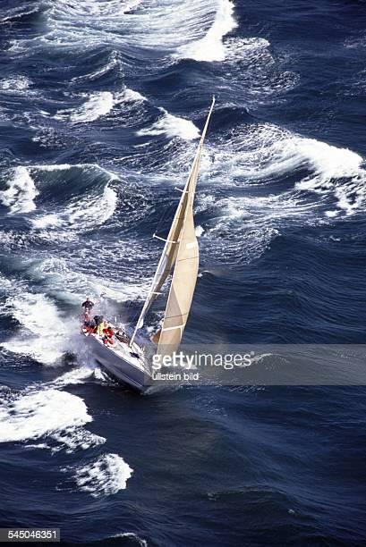 regatta yacht on stormy sea aerial photo