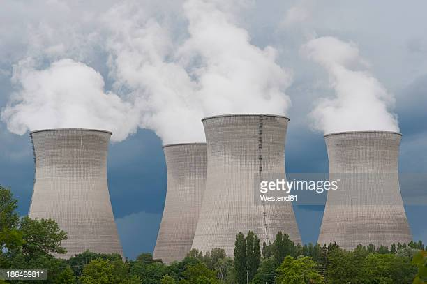 france, rhone, smoking cooling towers of power plant - atomic imagery photos et images de collection