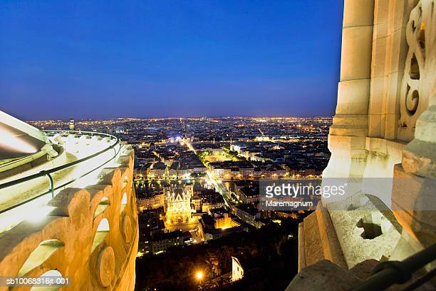 France, Rhone-Alpes, Lyon, illuminated cityscpe from top of basilica Notre Dame de Fourviere at dusk