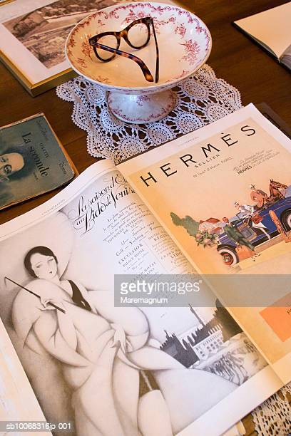 France, Rhone-Alpes, Lyon, Tony Garnier Apartment-Museum, fashion magazine on table, close-up