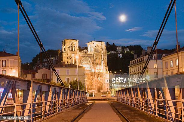 France, Rhone-Alpes, Rhone Valley, Isere, Vienne, Saint-Maurice Cathedral illuminated at dusk, bridge in foreground
