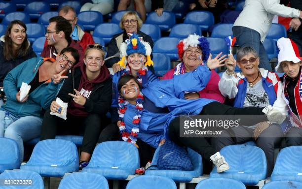 France rugby supporters pose for a photograph ahead of the Women's Rugby World Cup 2017 pool C rugby match between France and Australia at The UCD...