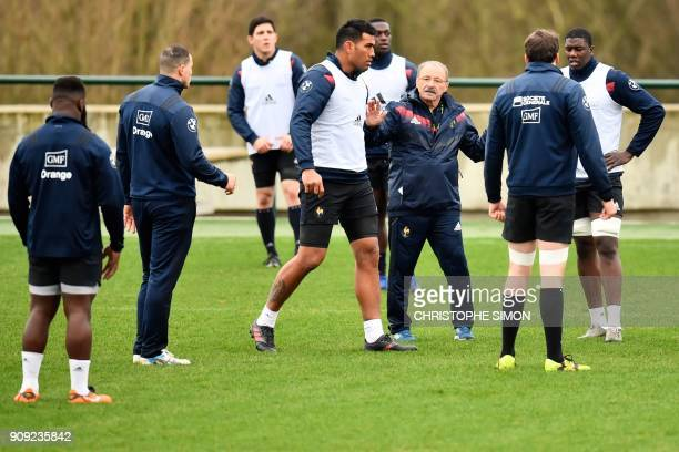 France rugby union national team coach Jacques Brunel speaks to his players during a training session on January 23 2018 at the team's training camp...