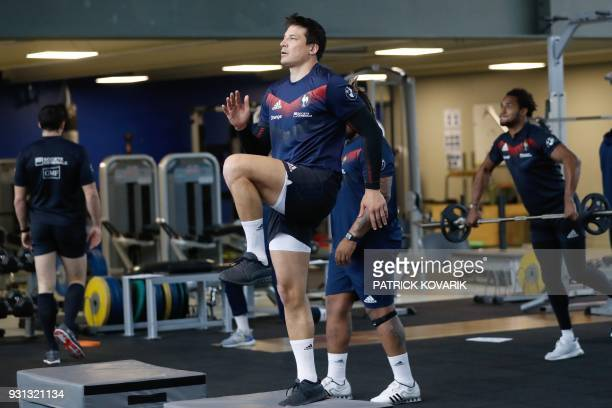 France rugby union national team flyhalf François TrinhDuc warms up prior to take part in weightlifting session on March 13 2018 in Marcoussis as...