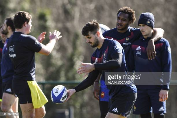 France rugby union national team fullback Hugo Bonneval controls the ball during a training session on March 14 2018 in Marcoussis as part of the...