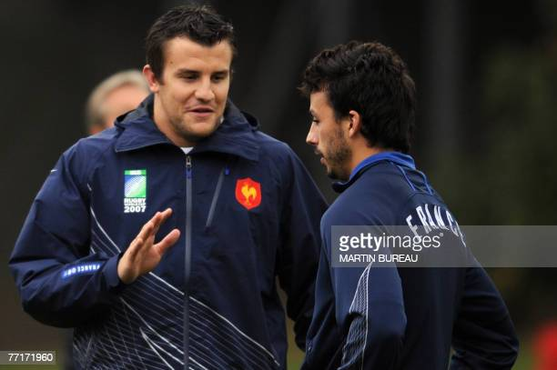France rugby union national team fullbacks Damien Traille and Clement Poitrenaud speak during a training session 03 October 2007 in Cardiff France...