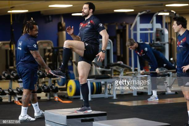 France rugby union national team player Geoffrey Doumayrou warms up prior to a weightlifting session on March 13 2018 in Marcoussis as part of the...