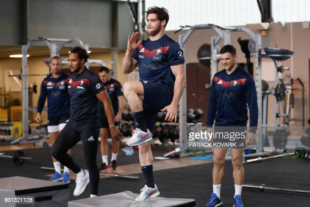 France rugby union national team player Maxime Machenaud warms up prior to take part in a weightlifting session on March 13 2018 in Marcoussis as...