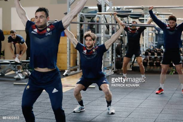 France rugby union national team player Maxime Machenaud warms up prior to a weightlifting session on March 13 2018 in Marcoussis as part of the...