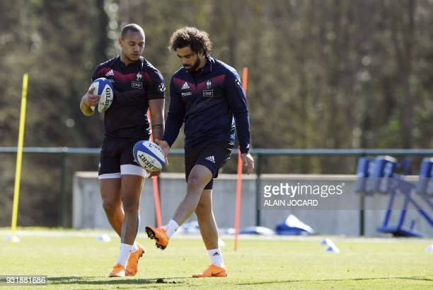 France rugby union national team players Gael Fickou and Yoann Huget take part in a training session on March 14 2018 in Marcoussis as part of the...