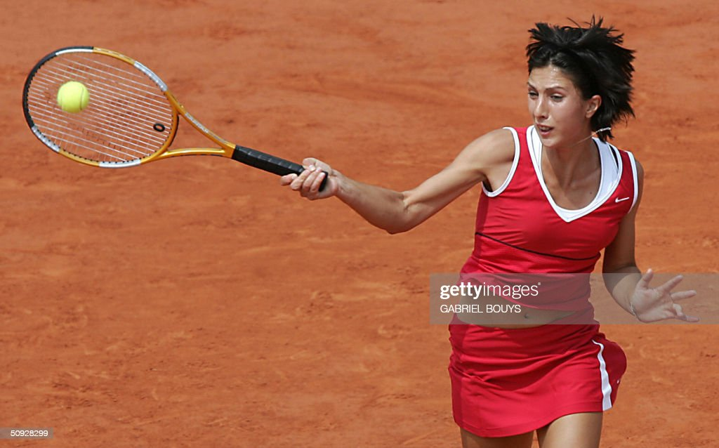 Russian Anastasia Myskina hits a shot to Russian Elena Dementieva in the women's final at Roland Garros during the French Open in Paris 05 June 2004.