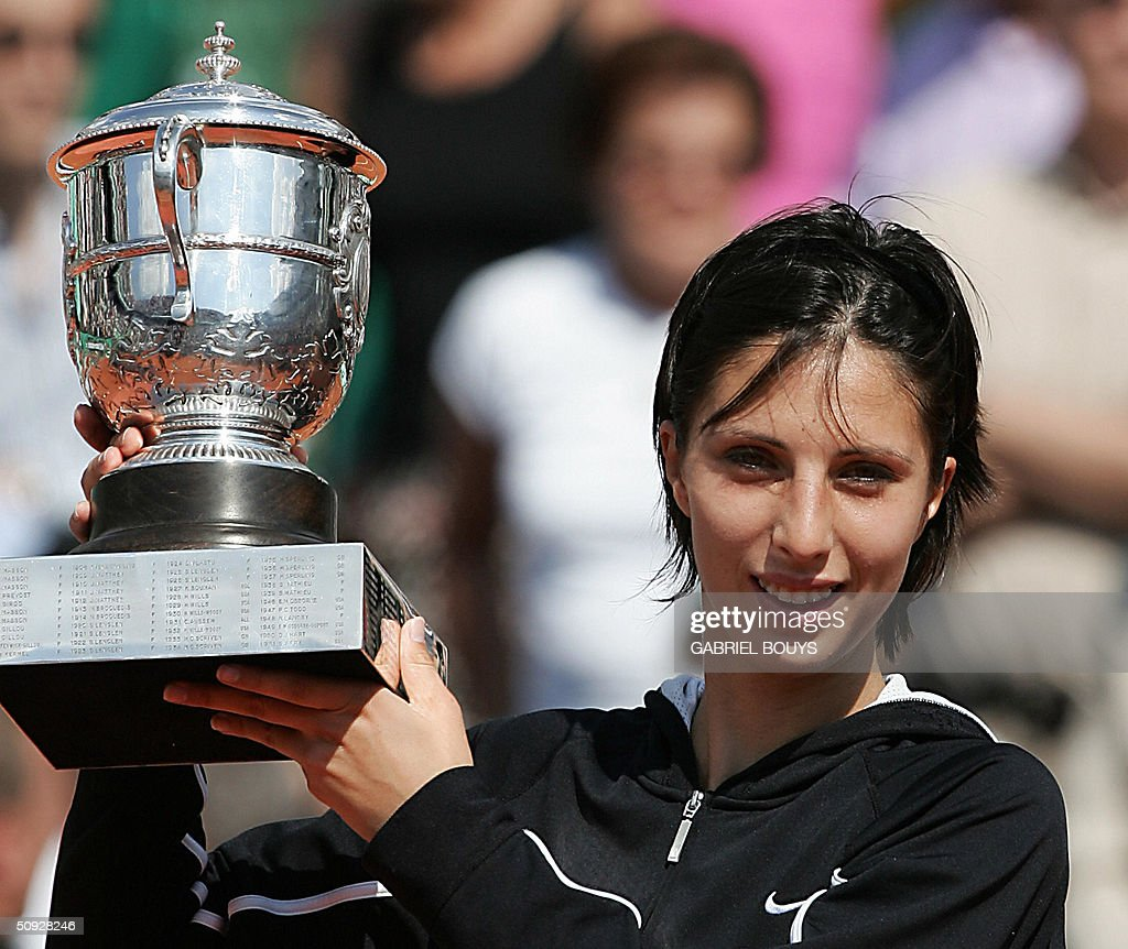 Russian Anastasia Myskina poses with the trophy after defeating Russian Elena Dementieva in the women's final at Roland Garros during the French Open in Paris 05 June 2004.