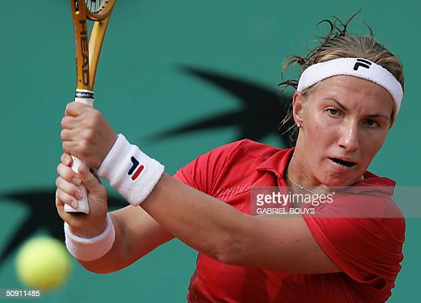 Russian Svetlana Kuznetsova hits a backhand to Russian Anastasia Myskina in the fourth round of the French Open at Roland Garros in Paris 30 May...