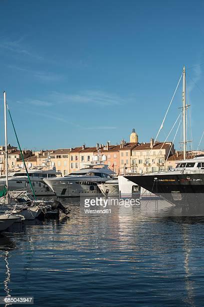 france, saint-tropez, marina and clock tower in background - saint tropez fotografías e imágenes de stock