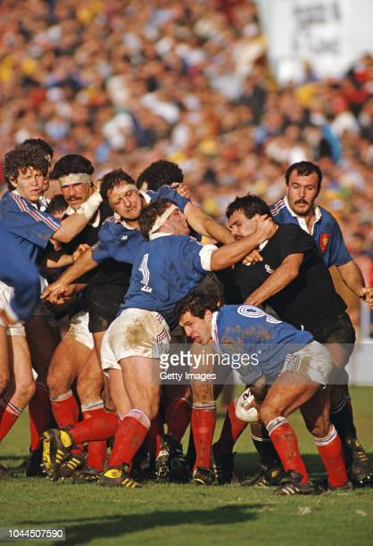France scrum half Pierre Berbizier prepares to pass the ball as prop Pascal Ondarts holds off All Black player Gary Whetton during the 1987 Rugby...