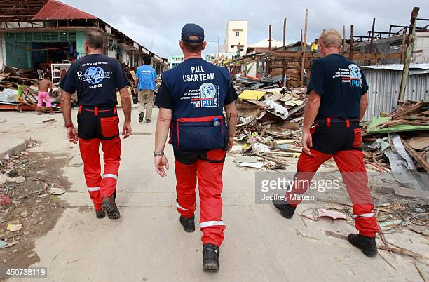 France search and rescue teams walk downtown as they help in humanitarian mission in the typhoon hit town on November 20 2013 in Guiuan Eastern Samar...