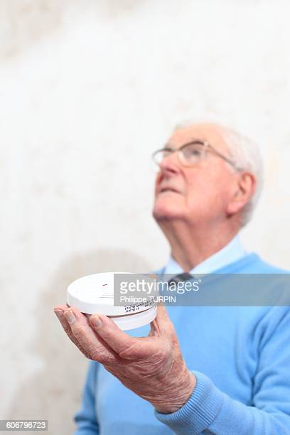 France, senior and smoke detector