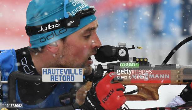 France Simon Desthieux competes at the shooting range during the men's 4x75km relay event of the IBU Biathlon World Cup in Ruhpolding southern...