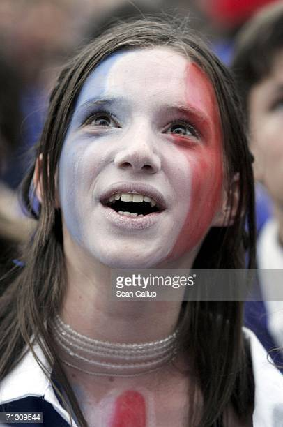 France soccer fan painted in the colors of the French flag reacts to play during their FIFA World Cup 2006 Round of 16 match against Spain at an...