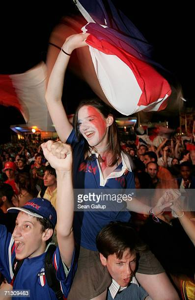 France soccer fans celebrate the country's 3-1 victory over Spain in the FIFA World Cup 2006 Round of 16 match at an open-air public viewing area...