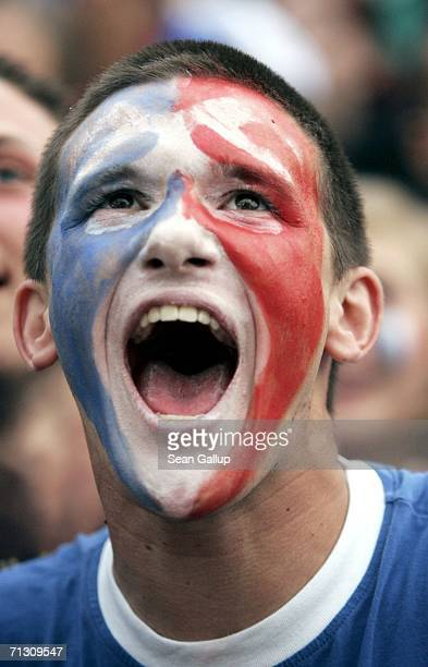 France soccer fans react to play during their FIFA World Cup 2006 Round of 16 match against Spain at an open-air public viewing area June 27, 2006 in...