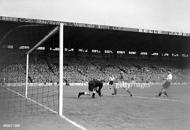 France soccer national team player Léon Deladerrière faces the German goalkeeper during the match FranceWest Germany on October 051952 at...