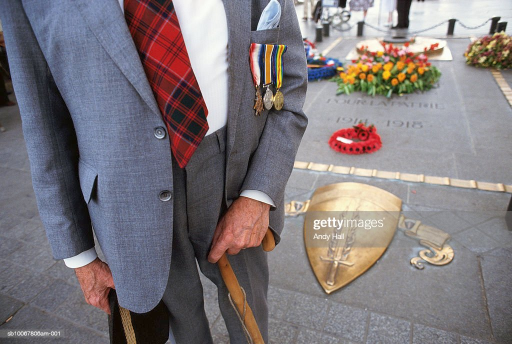 France, Somme, mid section of veteran in front of World War I memorial