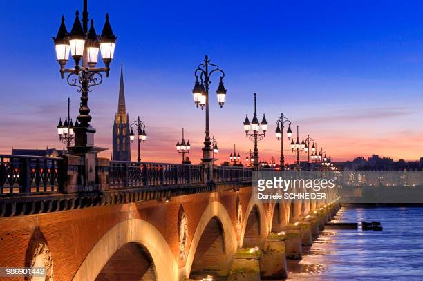 france, south-western france, bordeaux, arrow of the basilica saint-michel and stone bridge at sunset - ボルドー ストックフォトと画像