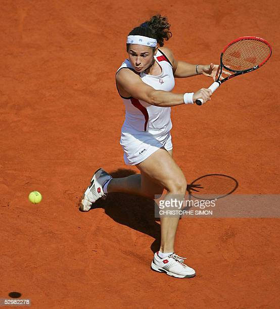 Spain Virginia Ruano Pascua returns the ball to Justine HeninHardenne l during their second round match of the tennis French Open at Roland Garros 26...