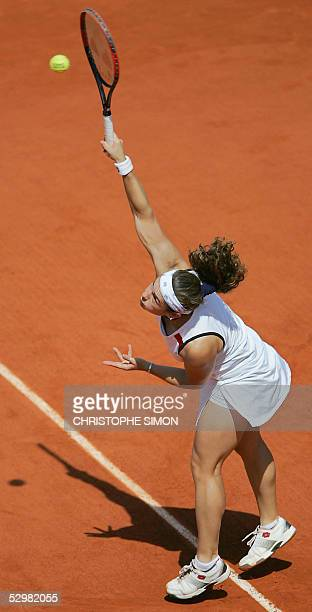 Spain Virginia Ruano Pascual returns the ball Belgium Justine HeninHardenne during their second round match of the tennis French Open at Roland...