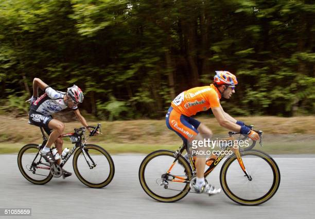 Spaniard Haimar Zubeldia rides in front of Italian Filippo Simeoni during their breakwaya in the ninth stage of the 91st Tour de France cycling race...