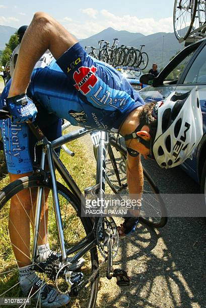 Spaniard Roberto Heras cheks his bike after a fall during the 13th stage of the 91st Tour de France cycling race between Lannemezan and Plateau de...