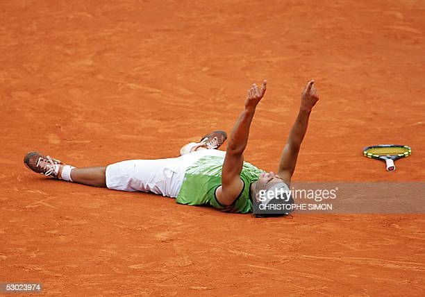 Spanish Rafael Nadal celebrates winning against Argentinian Mariano Puerta after their men's final match of the tennis French Open at Roland Garros...