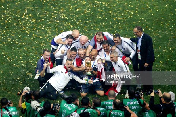 France staff members celebrate with the World Cup trophy following the 2018 FIFA World Cup Final between France and Croatia at Luzhniki Stadium on...
