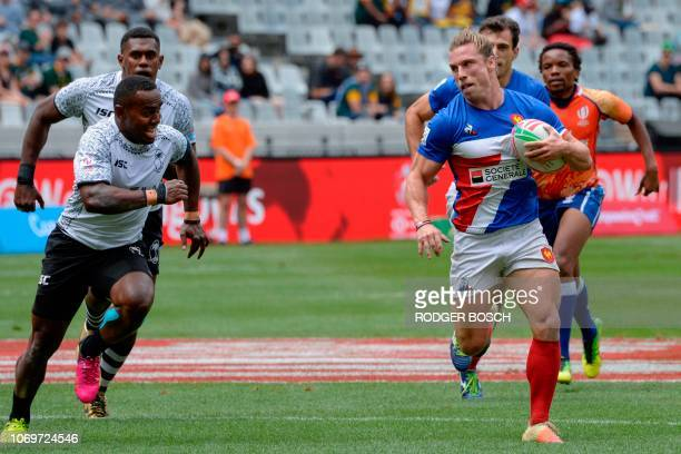 France Stephen Parez runs with the ball during France vs Fiji on the first day of the Rugby Sevens tournament on December 8 at the Cape Town Stadium...