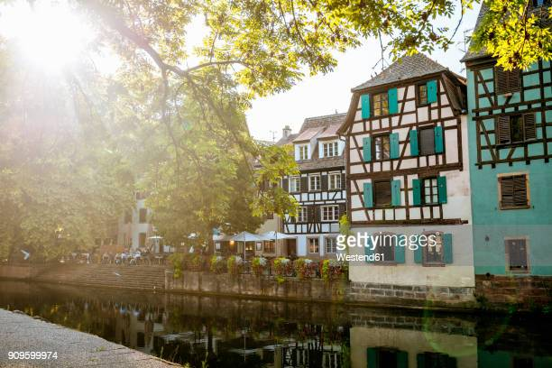 france, strasbourg, half-timbered houses at river iii at sunset - strasbourg stock pictures, royalty-free photos & images