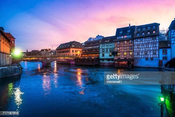 France, Strasbourg, La Petite France, with L'Ill river and half-timbered houses at twilight