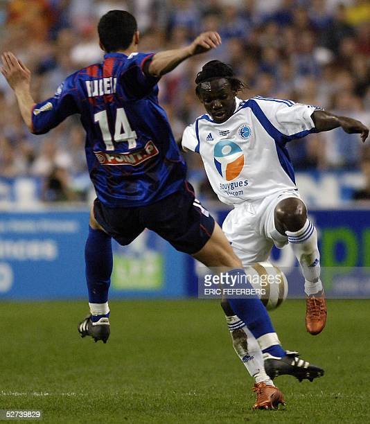 Strasbourg's Ivorian defender Arthur Boka vies with Caen's midfielder Yohan Eudeline during the French League Cup final football match Caen vs...