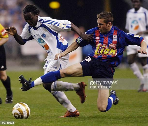 Strasbourg's Ivorian defender Arthur Boka vies with Caen's midfielder Benoit Lesoimier during the French League Cup final football match Caen vs...