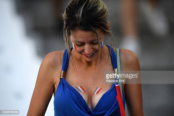 France supporter arrives for the start of the Euro 2016 semifinal football match between Germany and France at the Stade Velodrome in Marseille on...