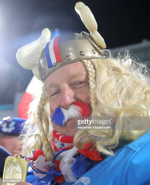 France supporter celebrates after Team France wins the gold medal during the Biathlon 2x6km Women 2x75km Men Mixed Relay on day 11 of the PyeongChang...