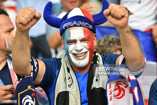 A France supporter cheers prior to the Euro 2016 semifinal football match between Germany and France at the Stade Velodrome in Marseille on July 7...