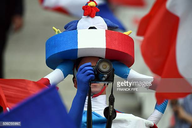 France supporter takes pictures prior to the Euro 2016 group A football match between France and Romania at Stade de France, in Saint-Denis, north of...
