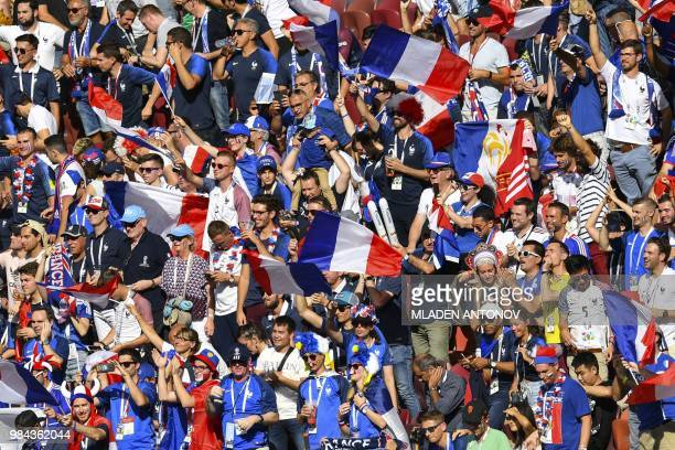TOPSHOT France supporter wave the national flage during the Russia 2018 World Cup Group C football match between Denmark and France at the Luzhniki...