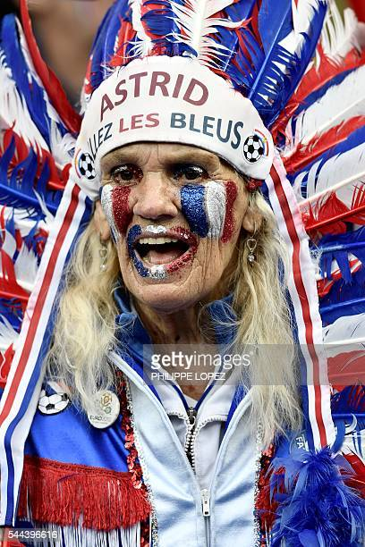 A France supporter wearing head dress with the lettering 'Astrid allez les bleus' is pictured ahead the Euro 2016 quarterfinal football match between...