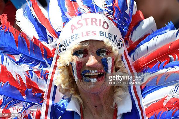 A France supporter with 'Astrid allez les bleus' written on her headdress is pictured ahead the Euro 2016 round of 16 football match between France...